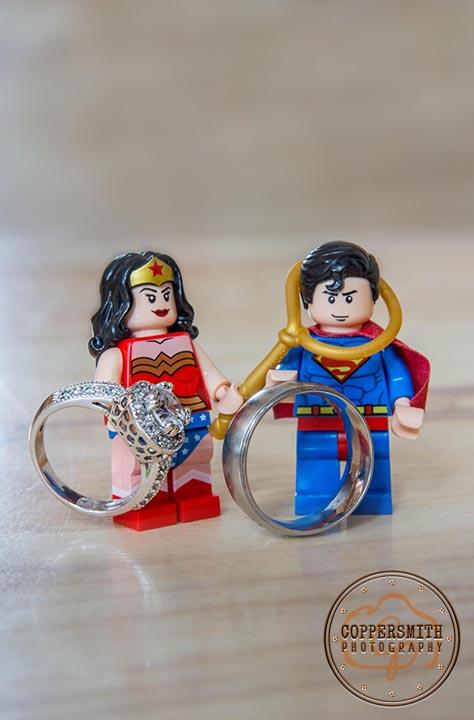wonder woman and superman wedding rings lego character photograph